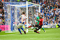 Ashley Young of Manchester United (18) blocks Dale Stephens of Brighton & Hove Albion (6) shot at goal  during the Premier League match between Brighton and Hove Albion and Manchester United at the American Express Community Stadium, Brighton and Hove, England on 19 August 2018. Photo by Edward Thomas / PRiME Media Images.