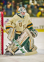 29 December 2013:  University of Vermont Catamount Goaltender Mike Santaguida, a Freshman from Mississauga, Ontario, in first period action against the Canisius College Golden Griffins at Gutterson Fieldhouse in Burlington, Vermont. The Catamounts defeated the Golden Griffins 6-2 to capture the 2013 Sheraton/TD Bank Catamount Cup NCAA Hockey Tournament for the second straight year. Mandatory Credit: Ed Wolfstein Photo *** RAW (NEF) Image File Available ***
