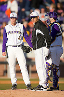 East Carolina Pirates head coach Billy Godwin #28, Seth Maness #43 and Jared Avchen #22 wait for the new pitcher to arrive on the mound at Clark-LeClair Stadium on February 19, 2010 in Greenville, North Carolina.   Photo by Brian Westerholt / Four Seam Images