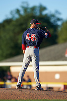Lowell Spinners pitcher Javier Rodriguez (46) looks in for the sign during a game against the Batavia Muckdogs on August 12, 2015 at Dwyer Stadium in Batavia, New York.  Batavia defeated Lowell 6-4.  (Mike Janes/Four Seam Images)