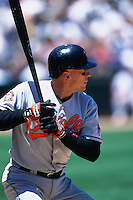 OAKLAND, CA - Cal Ripken Jr. of the Baltimore Orioles bats during the game against the Oakland Athletics at the Oakland Coliseum in Oakland, California on June 2, 2001. Photo by Brad Mangin