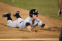 Staten Island Yankees outfielder Ben Gamel #24 dives into third base during game one of the NY-Penn League Championship Series against the Auburn Doubledays at Falcon Park on September 12, 2011 in Auburn, New York.  Staten Island defeated Auburn 9-2.  (Mike Janes/Four Seam Images)