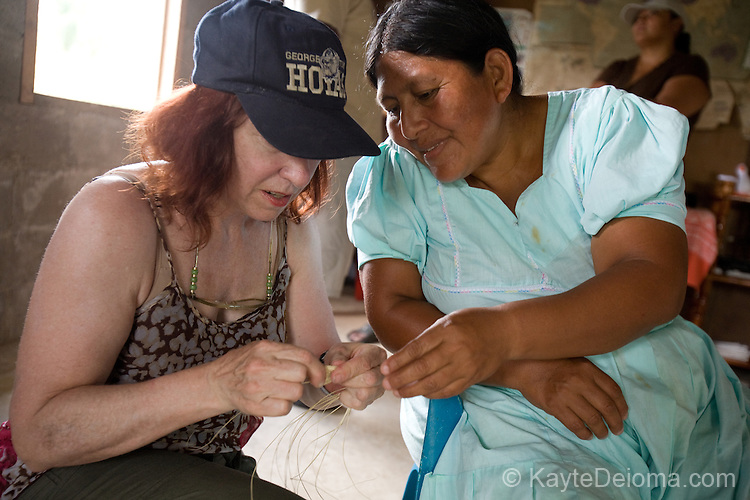 Mayan craftswoman Antonia Choco shows visitors how to weave traditional baskets in the Mayan community of San Miguel, Toledo, Belize