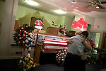 August 25, 2007. Kinston, NC.. A viewing of the coffin of Spc. Steven R. Jewell was held at Howard and Carter Funeral Home i Kinston, NC. Spc. Steven R. Jewell was killed in a helicopter crash  near the Iraqi city of Fallujah on August 14, 2007..Jack Wisener, Spc. Jewell's stepfather, hug a friend at the coffin.. .