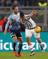 Calcio, Serie A: Lazio vs Juventus. Roma, stadio Olimpico, 4 dicembre 2015.<br /> Juventus' Paulo Dybala, right,is challenged by Lazio's Santiago Gentiletti during the Italian Serie A football match between Lazio and Juventus at Rome's Olympic stadium, 4 December 2015.<br /> UPDATE IMAGES PRESS/Riccardo De Luca