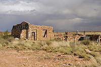 """The Mountain Lion attraction at Two Guns, Arizona, sits abandoned. Two Guns is located in Arizona, east of Flagstaff, on what was formerly Route 66. Two Guns was originally called """"Canyon Lodge"""" when the National Trail Highway moved westward. Later, the National Trail was re-named Route 66, the site's name was changed to Two Guns, because the proprietor of the facilities located there was one Henry E. Miller, who called himself """"Two Gun Miller.""""  During the heyday of Route 66, Two Guns became one of the numerous tourist traps along the way, with a gas station, overnighting accommodations, a food emporium, as well as a zoo. Two Guns went into decline with the building of the Interstate. Photographed 04/07."""