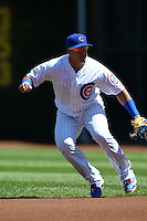 Chicago Cubs second baseman Javier Baez (9) fields a ground ball during a game against the Milwaukee Brewers on August 14, 2014 at Wrigley Field in Chicago, Illinois.  Milwaukee defeated Chicago 6-2.  (Mike Janes/Four Seam Images)