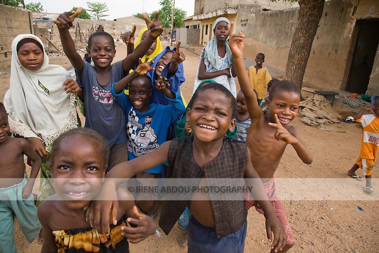 Children in Kano, Nigeria run toward the camera.