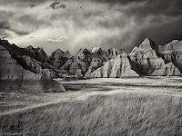 Grass meadow and colorful rocks. Badlands National Park, South Dakota.