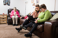 FAO: Society <br /> Pictured: Alys Phillips (C) and resident Sharon Wieland use a laptop - Mandy Patton sits in the chair on the left<br /> Re: Care worker Alys Phillips, 23, who looks after people with learning disabilities in Brecon, mid Wales, UK. Wednesday 01 February 2017
