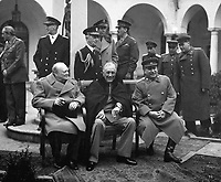 """Conference of the Big Three at Yalta makes final plans for the defeat of Germany.  Here the """"Big Three"""" sit on the patio together, Prime Minister Winston S. Churchill, President Franklin D. Roosevelt, and Premier Josef Stalin.  February 1945. (Army)<br /> Exact Date Shot Unknown<br /> NARA FILE #:  111-SC-260486<br /> WAR & CONFLICT BOOK #:  750"""