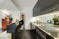 BNPS.co.uk (01202) 558833. <br /> Pic: OrlandoReid/BNPS<br /> <br /> Pictured: Kitchen. <br /> <br /> A flat in a ten-storey Art Deco mansion block that was the fictional home of TV detective Hercule Poirot has gone up for rent for £1,950 a month.<br /> <br /> Grade II listed Florin Court in East London was used for filming the long-running ITV series about Agatha Christie's iconic detective.<br /> <br /> The one-bedroom ground floor flat includes a double bedroom, an open plan reception room and kitchen, and a study or home office and<br /> a marble-tiled family bathroom.<br /> <br /> The exterior of the building has strong Art Deco motifs, many of which were used in the filming of Poirot, for 24 years, from 1989 to 2013.
