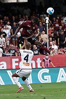 2nd October 2021; Arechi Stadium, Salerno, Italy; Serie A football, Salernitana versus Genoa : Cedric  Goddo of Salernitana clins bigh to win the header from Chriscito of Genoa