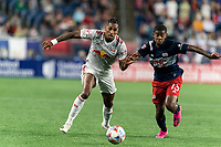 FOXBOROUGH, MA - JUNE 23: Fabio Gomes #9 of New York Red Bulls and Maciel #13 of New England Revolution battle for the ball during a game between New York Red Bulls and New England Revolution at Gillette Stadium on June 23, 2021 in Foxborough, Massachusetts.