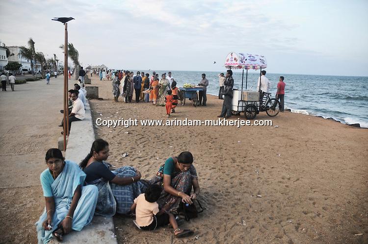 Indian tourists at the sea beach of Pondicherry. Arindam Mukherjee