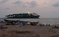 Barberyn (Beruwala) Light comes on at dusk as fishermen relax at day's end -Beruwala, Sri Lanka