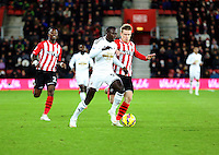 Pictured: Modou Barrow of Swansea (C) Sunday 01 February 2015<br />