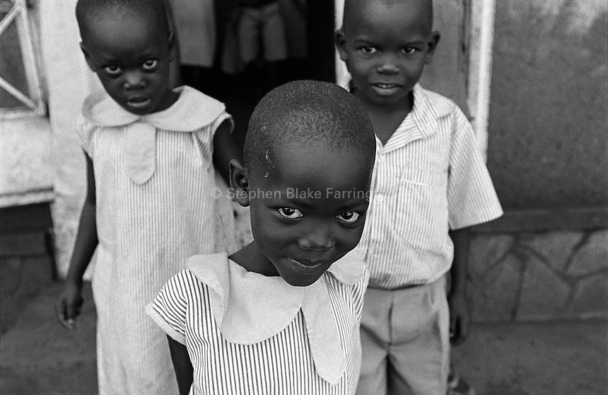 Break time at Rehaboth Integrated School. Most of the 130 plus children that attend this school are orphans due to HIV/AIDS. Uganda has an estimated 1.5 million people infected with HIV/AIDS and contains over 1 million orphans. Bugembe, Jinja District, Uganda, Africa. June 2004 © Stephen Blake Farrington