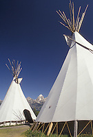 teepee, Grand Teton National Park, Rocky Mountains, Grand Teton, Grand Teton Mountains, Teton Range, Wyoming, Teepees are displayed at Moose Village in Grand Teton National Park in the state of Wyoming. A view of the Teton mountain range is in the distance.
