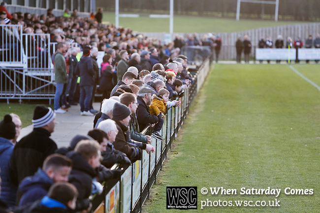 Darlington fans watching the second half. Darlington 1883 v Southport, National League North, 16th February 2019. The reborn Darlington 1883 share a ground with the town's Rugby Union club. <br /> After several years of relegations, bankruptcies, and ground moves, the club is fan owned, and back on an even keel in the National League North.<br /> A 0-0 draw with Southport was marred by a broken leg and dislocated knee suffered by Sam Muggleton, Darlington's on loan left back.<br /> Both teams finished the season in lower mid table.