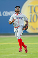 Left fielder Leandro Castro #18 of the Lakewood BlueClaws tracks a fly ball against the Kannapolis Intimidators at Fieldcrest Cannon Stadium July 14, 2010, in Kannapolis, North Carolina.  Photo by Brian Westerholt / Four Seam Images