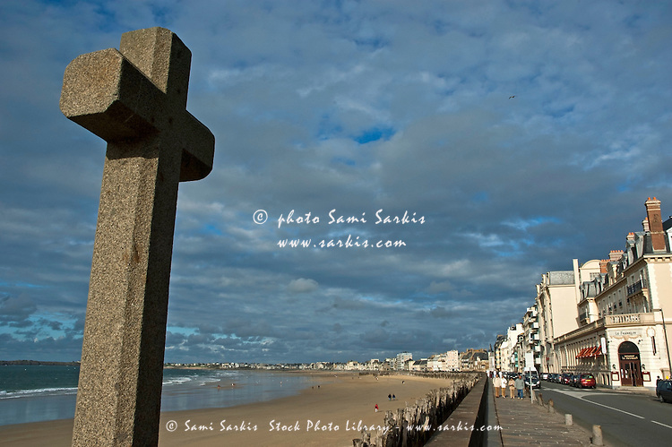 Old stone cross watching over the beachfront at Saint-Malo, Brittany, France.