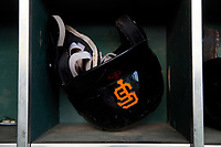 A San Francisco Giants batting helmet in the dugout before an Arizona League game between the AZL Giants Black and the AZL Giants Orange on July 19, 2019 at the Giants Baseball Complex in Scottsdale, Arizona. The AZL Giants Black defeated the AZL Giants Orange 8-5. (Zachary Lucy/Four Seam Images)