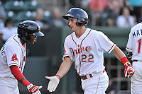 Third baseman Mitchell Gunsolus (22) of the Greenville Drive is congratulated by Luis Alejandro Basabe (5) after hitting a home run in a game against the Augusta GreenJackets on Wednesday, May 4, 2016, at Fluor Field at the West End in Greenville, South Carolina. Greenville won, 6-3. (Tom Priddy/Four Seam Images)