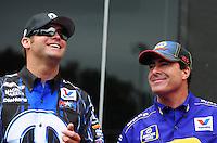 Jun. 17, 2012; Bristol, TN, USA: NHRA funny car drivers Matt Hagan (left) and teammate Ron Capps during the Thunder Valley Nationals at Bristol Dragway. Mandatory Credit: Mark J. Rebilas-