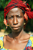 Gambia. Portrait of a woman with a headscarf/turban.