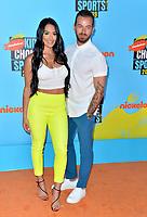 SANTA MONICA, USA. July 11, 2019: Artem Chigvintsev & Nikki Bella at Nickelodeon's Kids' Choice Sports Awards 2019 at Barker Hangar.<br /> Picture: Paul Smith/Featureflash