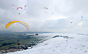 30/01/12.  ..More than twenty paragliders take to the chilly skies over Mam Tor, high above Castleton in the Derbyshire Peak District. Cold east winds made for perfect winter flying conditions - the 'linear' winds giving good lift when the thermals are few and far between...All rights reserved. F Stop Press 01335 300098..Local copyright law applies to all print & online usage.