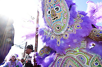 Victor Harris, Big Chief of the Fi Yi Yi, dances while surrounded by his tribe in the Treme neighborhood of New Orleans on Mardi Gras day, February 16, 2010.