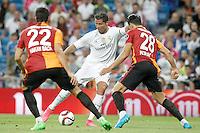 Real Madrid's Cristiano Ronaldo (c) and Galatasaray's Hakan Balta (l)and Koray Gunter during XXXVI Santiago Bernabeu Trophy. August 18,2015. (ALTERPHOTOS/Acero)