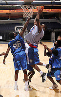 WF DeQuan Jones (Marietta, GA / Wheeler) shoots the ball in front of C/F L.A. Pomlee (Davenport, IA / Davenport Central) during the NBA Top 100 Camp held Thursday June 21, 2007 at the John Paul Jones arena in Charlottesville, Va. (Photo/Andrew Shurtleff)