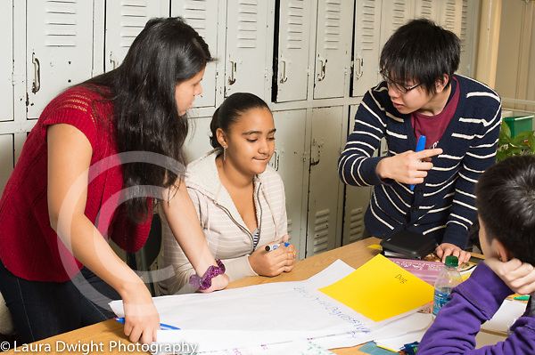 Education high school group of male and female students talking and collaborating