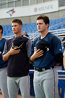 Lakeland Flying Tigers starting pitcher Casey Mize (right) stands next to Matt Manning for the national anthem before a game against the Dunedin Blue Jays on July 31, 2018 at Dunedin Stadium in Dunedin, Florida.  Dunedin defeated Lakeland 8-0.  (Mike Janes/Four Seam Images)