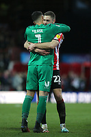 David Raya of Brentford hugs Henrik Dalsgaard at the final whistle to celebrate their 3-2 victory during Brentford vs Middlesbrough, Sky Bet EFL Championship Football at Griffin Park on 8th February 2020