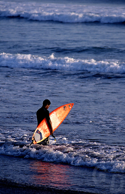 Early morning in Bali Indonesia, Surfer waiting for the waves,