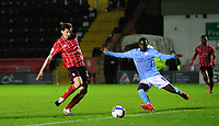 Lincoln City's Conor McGrandles has a shot under pressure from Manchester City U21's Claudio Gomes<br /> <br /> Photographer Chris Vaughan/CameraSport<br /> <br /> EFL Papa John's Trophy - Northern Section - Group E - Lincoln City v Manchester City U21 - Tuesday 17th November 2020 - LNER Stadium - Lincoln<br />  <br /> World Copyright © 2020 CameraSport. All rights reserved. 43 Linden Ave. Countesthorpe. Leicester. England. LE8 5PG - Tel: +44 (0) 116 277 4147 - admin@camerasport.com - www.camerasport.com