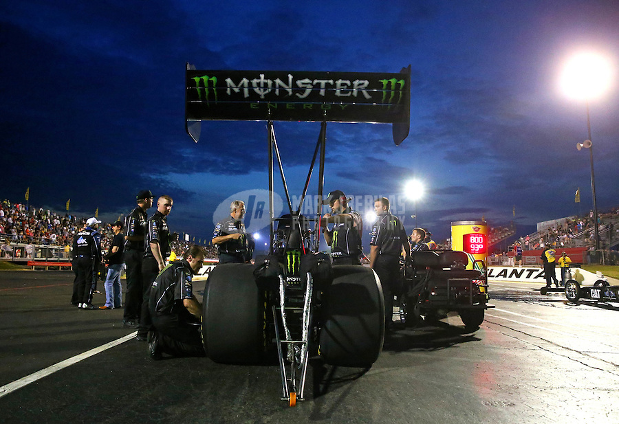 May 15, 2015; Commerce, GA, USA; Crew members prepare the car of NHRA top fuel driver Brittany Force during qualifying for the Southern Nationals at Atlanta Dragway. Mandatory Credit: Mark J. Rebilas-USA TODAY Sports