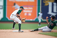 Fort Wayne TinCaps second baseman Kodie Tidwell (3) fields a throw as Gage Green (14) slides in during the first game of a doubleheader against the Great Lakes Loons on May 11, 2016 at Parkview Field in Fort Wayne, Indiana.  Great Lakes defeated Fort Wayne 3-0.  (Mike Janes/Four Seam Images)
