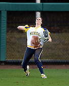 Michigan Wolverines outfielder Nicole Sappingfield (15) throws the ball in after catching a fly ball during the season opener against the Florida Gators on February 8, 2014 at the USF Softball Stadium in Tampa, Florida.  Florida defeated Michigan 9-4 in extra innings.  (Copyright Mike Janes Photography)