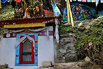 A temple of prayer wheel and a buddhist painting. One can find these kind temples and paintings all over Bhutan Arindam Mukherjee..