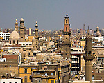 Cairo, Egypt -- View from the minarets of the Bab Zuwayla gate.  One of the three first gates installed around the historic walled city of Cairo, standing at the southern boundary of old Fatimid Cairo.  The two minarets atop this tower actually belong to the nearby Mosque of al-Mu'ayyad, which sits just inside this gate.  For a small fee, it is possible to climb the minarets for a spectacular view of old and new Cairo, featuring many minarets above the old city. © Rick Collier / RickCollier.com