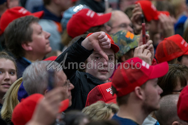 A supporter gives a thumbs down to the media during a Make America Great Again campaign rally at Atlantic Aviation in Moon Township, Pennsylvania on March 10th, 2018. Photo Credit: Alex Edelman/CNP/AdMedia