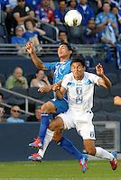 sidro Gutierrez (9) El Salvador wins the header against Andy Najar (14) Honduras... Honduras defeated El Salvador 3-2 after extra time to go through to the final at LIVESTRONG Sporting Park, Kansas City, Kansas.