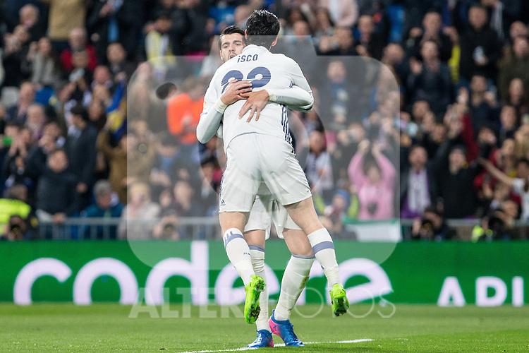 Isco Alarcon and Alvaro Morata of Real Madrid celebrates after scoring a goal during the match of Spanish La Liga between Real Madrid and UD Las Palmas at  Santiago Bernabeu Stadium in Madrid, Spain. March 01, 2017. (ALTERPHOTOS / Rodrigo Jimenez)