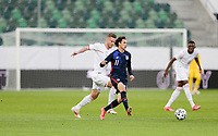 ST. GALLEN, SWITZERLAND - MAY 30: Brenden Aaronson #11 of the United States passes off the ball during a game between Switzerland and USMNT at Kybunpark on May 30, 2021 in St. Gallen, Switzerland.