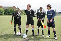 Match officials and the New North Rangers captain wait for the arrival of the Stratford Juniors skipper prior to the East London Advertiser Sunday Cup Final at Ive Farm Arena, Leyton - 25/05/08 - MANDATORY CREDIT: Gavin Ellis/TGSPHOTO - Self billing applies where appropriate - Tel: 0845 094 6026